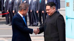 North Korean leader Kim Jong Un, right, shakes hands with South Korean President Moon Jae-in at the border village of Panmunjom in the Demilitarized Zone Friday, April 27, 2018. Kim made history Friday by crossing over the world's most heavily armed border to greet his rival, Moon, for talks on North Korea's nuclear weapons. (Korea Summit Press Pool via AP)